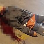 Corpo da vítima no chão