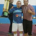 Adriano do Migué F.C. recebendo o troféu de 1º lugar da 2ª divisão